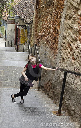 A young girl going up stairways