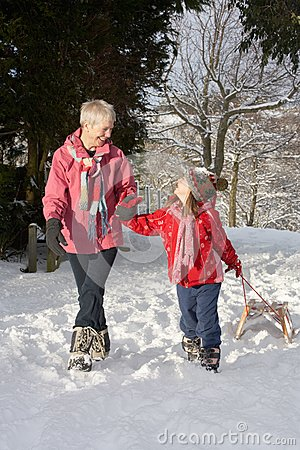 Young Girl With Grandmother Pulling Sledge