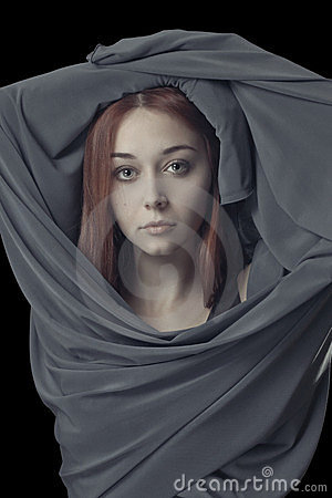 Young girl with grey cloth