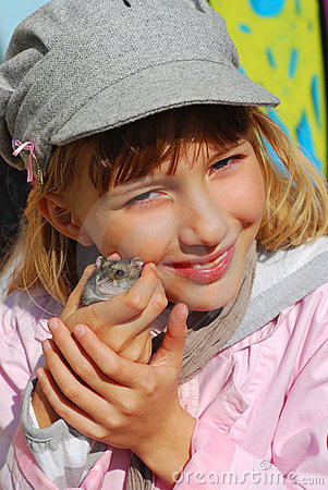 Young girl  with hamster outdoor