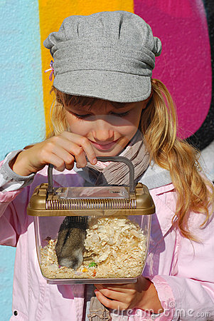 Young girl  with hamster in portable transporter