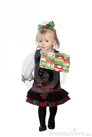 Young girl handing out presents