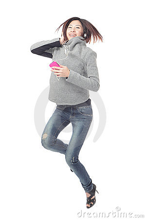 Young Girl happy jump and listen music