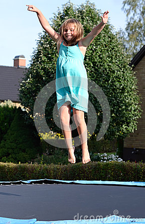 Young girl have a fun on the trampoline
