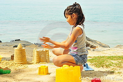 Young Girl Having Fun At The Beach