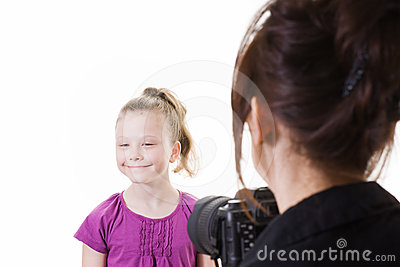 Young girl having her photo taken