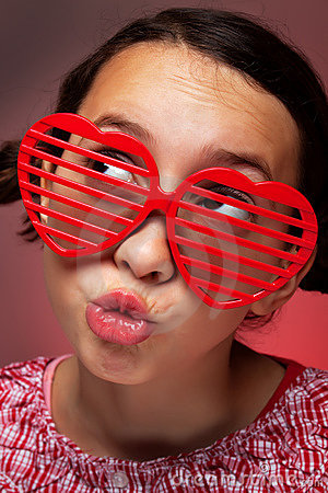Young girl with heart shaped shutter shades