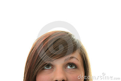 Young girl with her eyes looking away up