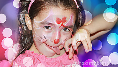 A YOUNG GIRL WITH HER FACE PAINTED