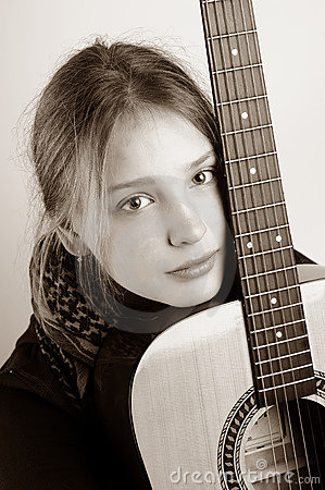 Young girl and hers guitar