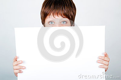 Young girl hiding a banner