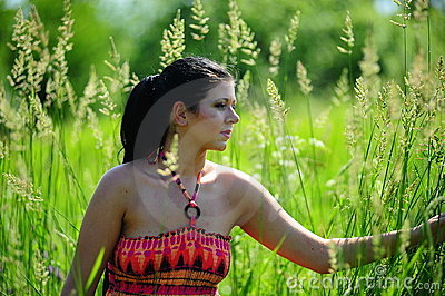 Young girl in high grass field
