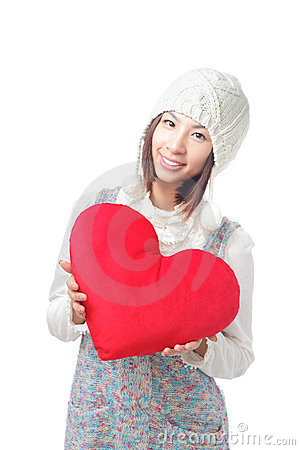 Young girl hold a love heart pillow