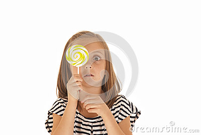 Young girl holdiing a sucker over her face, funny
