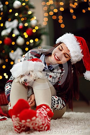 Free Young Girl Holding A Christmas Present Puppy Dog Royalty Free Stock Photos - 102352808