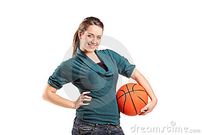 Young girl holding a basketball