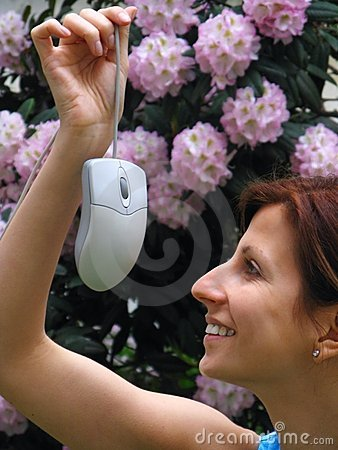 Young girl holding computer mouse