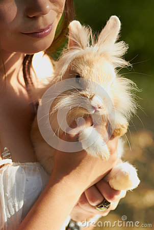 Young girl holding a decorative bunny