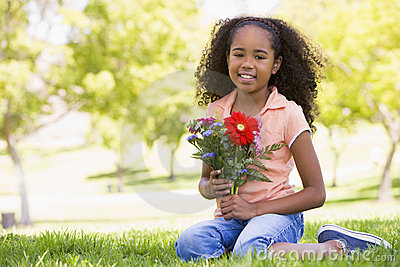 Young girl holding flowers