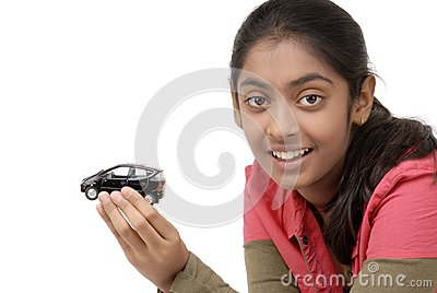 Young girl holding her dream car model