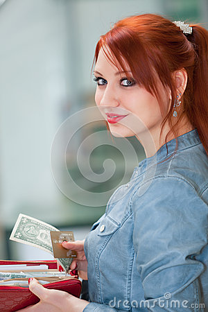 Young girl holding a money