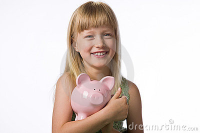 Young girl holding a piggy bank