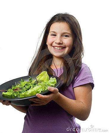 Young girl holding plate with salad