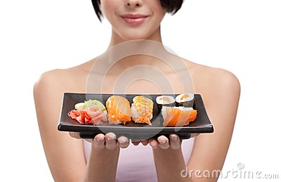 Young Girl Holding Plate Of Sushi Royalty Free Stock Images - Image: 25204029