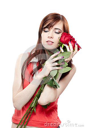 Young girl holding red roses isolated on white
