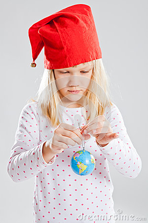 Young girl holding world in hands