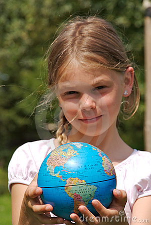 A young girl is holding the world in her hands