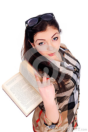 Young girl holds an opened book, got foxy look