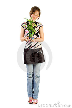 Young girl with home plant