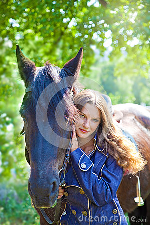 Young girl with a horse in the garden.