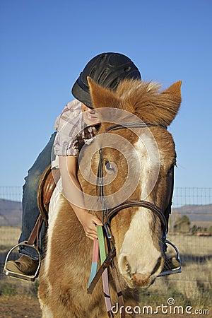 Young Girl Hugs Her Pony