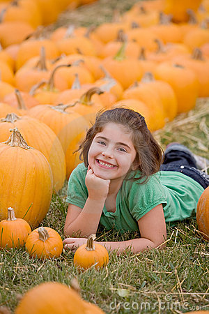 Free Young Girl In A Pumpkin Patch Royalty Free Stock Image - 10632116