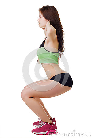 Free Young Girl In Short Shorts And A Sports Shirt Performs Squats. Royalty Free Stock Photography - 41919917