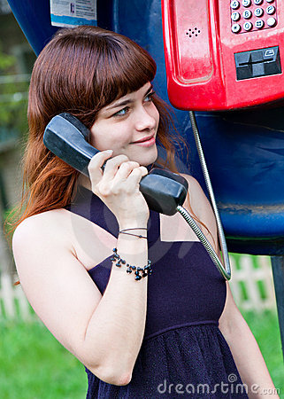 Free Young Girl In Telephone Box Stock Image - 15721951