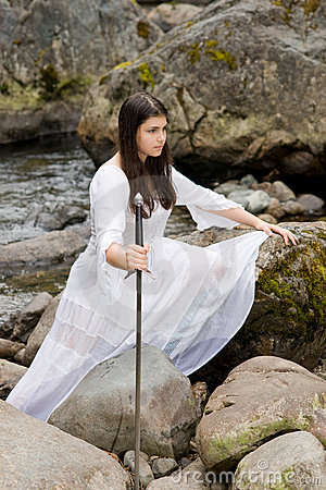 Free Young Girl In White Dress With Two Handed Sword Stock Photo - 15599000