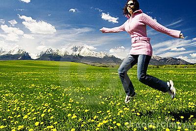 Young girl jumping on a meadow