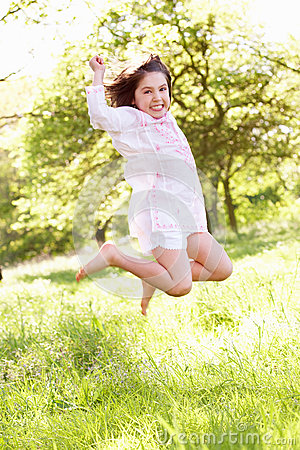 Young Girl Jumping In Summer Field
