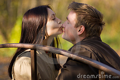 Young girl kisses in the nose a man