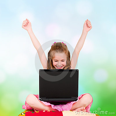 A young girl with a laptop