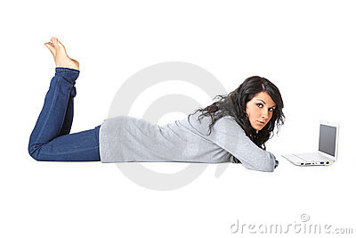 Young girl laying on the floor using a laptop