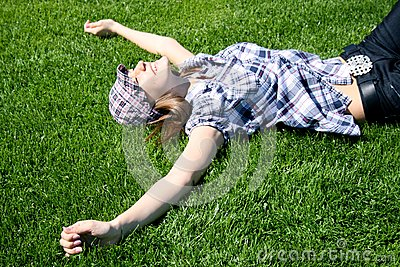 Young girl laying on the grass