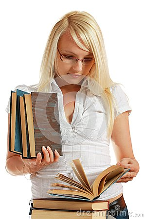 Young girl leaned over pile of books