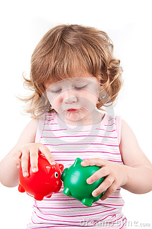 Young Girl lets her piggy banks kiss each other