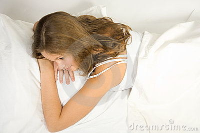 Young girl lie in bed