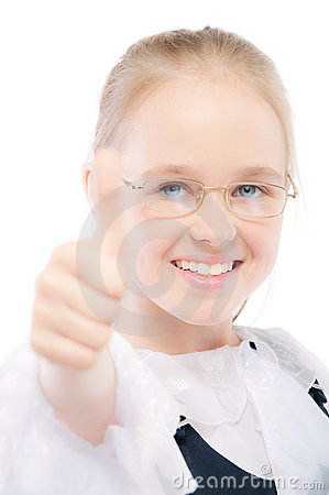 Young girl lifts thumb upwards