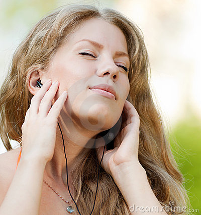 A Young Girl Listening Music Outdoor Royalty Free Stock Photo - Image: 21719765